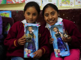 Kids from remote high altitude mountainous area in Peru received their Christmas gifts. The were asked to pose in front of the camera which they had never heard of. (Lexi Luo)